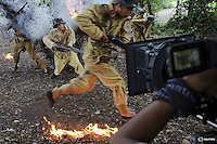 """The camera rolls as actors dressed as historical Chinese soldiers act as though they have been hit by artillery, during filming of """"The Last Prince"""" television series on location near Hengdian World Studios near Hengdian July 24, 2015. Mass battle scenes that involve special effects and more than a hundred actors and crew are often shot in one take. This makes it possible for the well-organised team to satisfy the huge appetite for productions about the war against Japan. Director Li Xiaoqiang said the series is about a Qing Dynasty prince, who joined the Chinese nationalist army after suffering family misfortune. """"After he learnt more about the Communist Party, the prince began to understand what real revolution and the anti-Japanese war meant, and turned to the Communist Party to fight Japan"""", the director added. According to local media, more than 10 new movies, 12 TV dramas, 20 documentaries and 183 war-themed stage performances will be released in China to coincide with the 70th anniversary of the end of World War Two. REUTERS/Damir Sagolj     TPX IMAGES OF THE DAYPICTURE 7 OF 28 FOR WIDER IMAGE STORY """"BEHIND THE SCENES OF A CHINESE WAR DRAMA"""".SEARCH """"SAGOLJ STUDIO"""" FOR ALL PICTURES."""