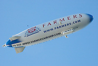 A Farmers Insurance blimp floats above Santa Monica Bay on  Thursday, February 3, 2011.