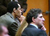 Sniper suspect John Allen Muhammad, left, rests his head in his hand as he and defense attorney Jonathan Shapiro, right, listen to court proceedings during his trial in the Virginia Beach Circuit Court in Virginia Beach, Virginia on November 12, 2003. <br /> Credit: Lawrence Jackson - Pool via CNP