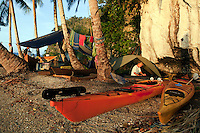 Raja Ampat Archipelago, West Papua, Indonesia, December 2010. A fishermans camp on a 2 meter wide strip of sand between 2 rocks becomes our base camp to explore the northern part of Kaboei bay. Thousands of small islands fringed by coral reefs and blue water mangroves litter the Raja Ampat archipelago. The turquoise and blue waters are teeming with marine life that forms the livelihood for the local Papuan population. The Raja Ampat Research & Conservation Centre (RARCC) supports the locals to develop a community based, sustainable tourism project, inviting visitors to explore their islands by sea kayak and experience the culture by staying amongst the local people in traditional style homestays. Photo by Frits Meyst/Adventure4ever.com