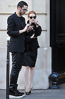 Jessica Chastain waiting for a taxicab in front of the Givenchy store, in Paris - France