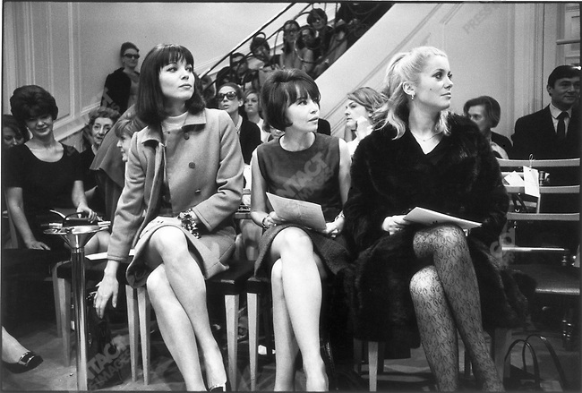 From left to right : Elsa Martinelli, Leslie Caron and Catherine Deneuve at Yves Saint Laurent's fashion show, Paris, France, February 1966