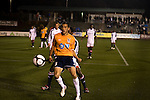 """March 14, 2009. Cary, NC.. The Carolina Railhawks went home in foul weather with a  1-0 victory over the New England Revolution of the MLS, in the inaugural """"Community Shield"""" match and their first professional outing under new coach, Martin Rennie. . Kupono Low, #3."""