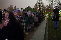 Moscow, Russia, 28/10/2011..Crowds on on Ploschad Revolutsii opposite the Bolshoi Theatre applaud while watching the theatre's gala reopening night on giant outdoor video screens. The theatre had been closed since 2005 for reconstruction work that cost some $700 million.