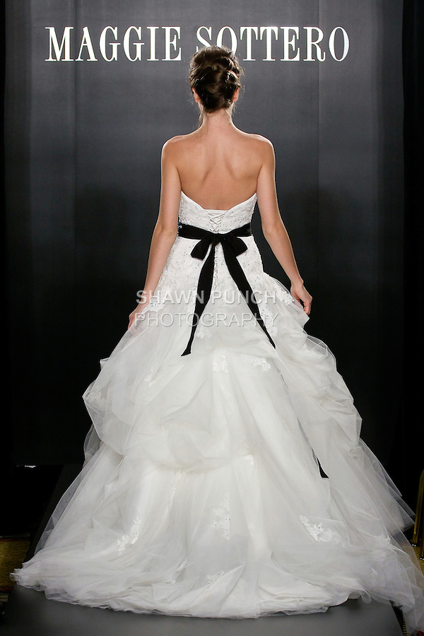 Model walks the runway in a Celine Haute Couture wedding dress from the Maggie Sottero Bridal Spring 2012 collection, during  Couture: New York Bridal Fashion Week 2012