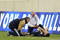 Sebastien Le Toux (9) of the Philadelphia Union is examined by a trainer after being injured during the second half. The New York Red Bulls defeated the Philadelphia Union 2-1 during a US Open Cup qualifier at Red Bull Arena in Harrison, NJ, on April 27, 2010.