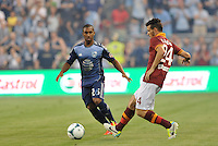 Sporting Park, Kansas City, Kansas, July 31 2013:<br /> Alessandro Florenzi (24) midfield AS Roma passes the ball, watched by Corey Ashe.<br /> MLS All-Stars were defeated 3-1 by AS Roma at Sporting Park, Kansas City, KS in the 2013 AT &amp; T All-Star game.