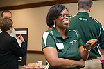 "Renea Morris, the Chief Marketing Officer for Univeristy Communications and Marketing, reads her ""fortune"" from a fortune cookie from the Procurement Services table at the Campus Communicator Network Expo in Nelson Commons on Wednesday, May 11, 2016. © Ohio University / Photo by Kaitlin Owens"