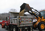 Wolcott, CT - 7 Jan. 2009 - 010709AL04 - A truck deposits Ice B' Gone into a town snow truck at the Public Works Department in Wolcott. The town started using the product this year.