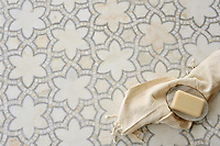Reina, a natural stone waterjet mosaic shown in Cloud Nine and Ming Green polished, is part of the Miraflores Collection by Paul Schatz for New Ravenna Mosaics. As seen in Elle Decor.