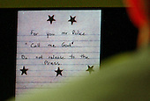 A note found inside of a bag at the Ponderosa Steak House, Ashland Virginia, shooting scene on October 19, 2002, is displayed on a screen during testimony in the trial of sniper suspect John Allen Muhammad in courtroom 10 at the Virginia Beach Circuit Court in Virginia Beach, Virginia, on October 31, 2003. <br /> Credit: Adrin Snider - Pool via CNP