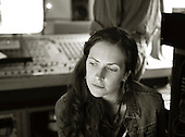 """Melanie Rowe, cellist with the """"Edge of Darkness Orchestra"""" Musicians to a recording just made.  An airstream trailer fitted out as a mobile sound recording engineer's mixing base .  Set up to record the """"Edge of Chaos Orchestra"""" playing inside the Blue Coconut Club, Pulborough, West Sussex."""