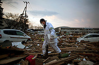 A rescue worker searches for bodies amongst the debris at Sendai airport. On 11 March 2011 a magnitude 9 earthquake struck 130 km off the coast of Northern Japan causing a massive Tsunami that swept across the coast of Northern Honshu. The earthquake and tsunami caused extensive damage and loss of life.