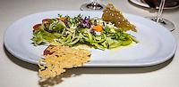 Mexican cuisine:  Fresh greens with Chiapas cheese, Quince jelly Até, fried hibiscus flowers, powdered chili piquin, and an orange vinaigrette.  Gran Velas Resort, Frida Restaurant,  Playa del Carmen, Riviera Maya, Yucatan, Mexico.