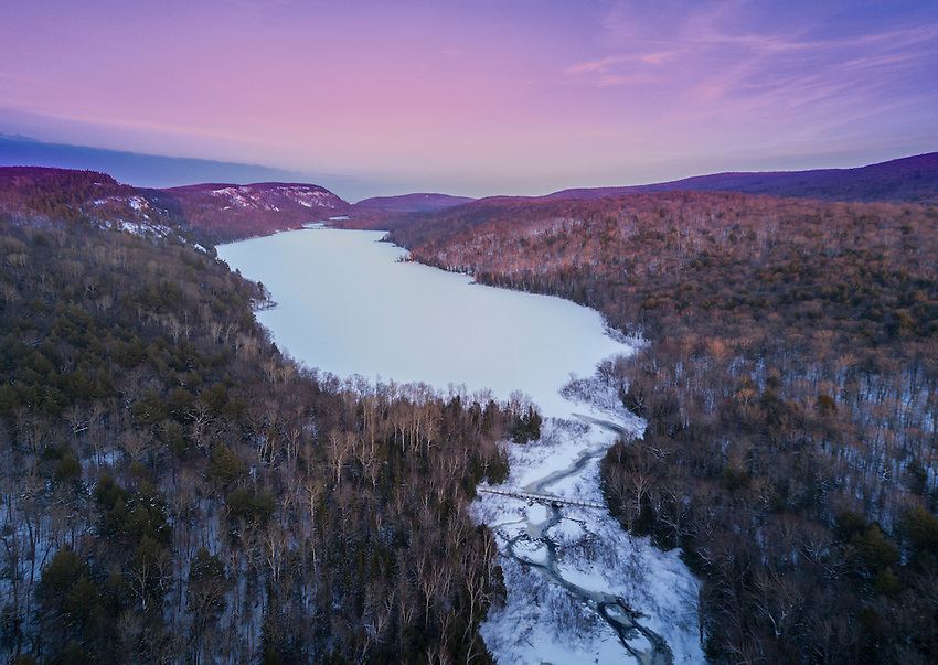 Winter aerial image of Lake of the Clouds at Porcupine Mountains Wilderness State Park at dusk.