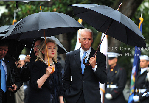 United States Vice President Joe Biden talks to U.S. Secretary of State Hillary Rodham Clinton at the state arrival for President Lee Myung-bak of South Korea on the South Lawn at the White House in Washington, D.C. on Thursday, October 13, 2011.  .Credit: Kevin Dietsch / Pool via CNP