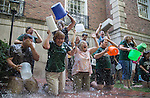 """Employees of the Financial Aid Department react as they pour buckets of ice water over their heads to participate in the """"Ice Bucket Challenge"""" in honor of Vicky Boyles, a coworker who was forced to leave her work as the Assistant Director of Financial Aid at the end of last March due to her battle against PMA. The group gathered behind Chubb Hall on College Green on Wednesday, August 27, 2014. Photo by Katelyn Vancouver"""
