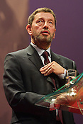David Blunkett speaks at the Labour Party conference, held in Glasgow, Scotland, on 15th February 2003. The same day massive anti-Iraq war peace protests were held throughout Britain, with the general public opposing the imminent invasion of Iraq.