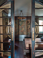 Sliding doors mark the entrance to the guest bedroom; a combination of Orientalist opulence and Art Deco chic