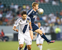 CARSON, CA - September 1, 2012: LA Galaxy defender Omar Gonzalez (4) and Vancouver Barry Robson (14) during the LA Galaxy vs the Vancouver Whitecaps FC at the Home Depot Center in Carson, California. Final score LA Galaxy 2, Vancouver Whitecaps FC 0.