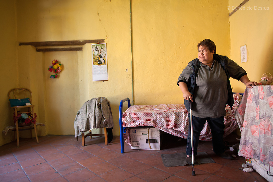 Normota, a resident of Casa Xochiquetzal, in her bedroom at the shelter in Mexico City, Mexico on October 4, 2012. Casa Xochiquetzal is a shelter for elderly sex workers in Mexico City. It gives the women refuge, food, health services, a space to learn about their human rights and courses to help them rediscover their self-confidence and deal with traumatic aspects of their lives. Casa Xochiquetzal provides a space to age with dignity for a group of vulnerable women who are often invisible to society at large. It is the only such shelter existing in Latin America. Photo by Bénédicte Desrus