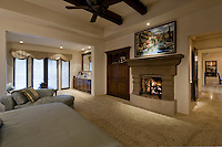 Large bedroom with sitting area, fireplace and beamed ceiling