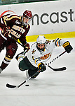 10 February 2012: University of Vermont Catamount defenseman Nick Bruneteau, a Sophomore from Omaha, NB, is tripped up by forward Paul Carey, a Senior from Weymouth, MA, during action against the Boston College Eagles at Gutterson Fieldhouse in Burlington, Vermont. The Eagles defeated the Catamounts 6-1 in their Hockey East matchup. Mandatory Credit: Ed Wolfstein Photo