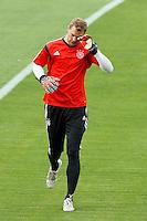 Goalkeeper Manuel Neuer of Germany wipes his eye