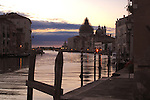 Early morning on the Grand Canal in Venice, Italy.Showing San Maria della Salute with dome covered in scaffolding. May 2007