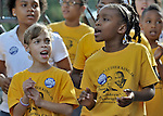 Girls in the Martin Luther King, Jr., Children's Choir sing before the start of the CROP Hunger Walk, held October 27, 2013, in Raleigh, North Carolina.