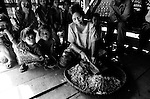 "Mekong Dam Victims - Cambodia. A woman prepares tobacco to be put under the sun for drying. After abandoning fishing, many villages in this area, by now far from the river, are changing from producing rice and vegetables to more profitable farming like tobacco, putting on risk their most important subsistent source. At least 55.000 people living near the Sesan river in Cambodia's Ratanakiri and Stung Treng provinces continue to suffer due to lost rice production, lost fishing income, drowned livestock and damaged vegetable gardens, and so also great economical losses, because of the unpredictable floodings from the Yali Falls Dam on the other side of the border in Vietnam. To this day, flash floodings have caused the deaths of at least 39 villagers from various ethnic minority groups living along the river. Despite this, four other major hydropower projects are now in operation or under construction on the Sesan River in Vietnam. Known as ""The Mother of Waters"", more than 60 million people depend on the Mekong river and its tributaries for food, fresh water, transport and other aspects of daily life. The construction of big dams is now threatening the life of these people aswell as the vital and unique ecosystem of the river."