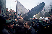 West Berlin, West Germany<br /> November 11, 1989<br /> <br /> German guards restrain people from climbing to the other side of the wall as a section is pulled down by west Germans. The East German government lifts travel and emigration restrictions to the West on November 9, 1989.