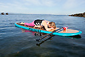 PE00288-00...WASHINGTON - Carly Hayden doing paddle board yoga in the Puget Sound at Brackett's Landing North, Edmonds.  (MR #H13)