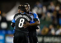Brandon McDonald of Earthquakes hugs Chris Wondolowski of Earthquakes during the game against the Red Bulls at Buck Shaw Stadium in Santa Clara, California.  San Jose Earthquakes defeated New York Red Bulls, 4-0.