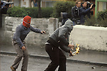 Northern Ireland Catholic youths rioting throwing petrol bombs.
