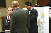 Defense attorney Peter Greenspun, left, and Jonathan Shapiro, right, talk with Prince William County (Virginia) prosecutor Paul Ebert, center back to camera, during the trial of sniper suspect John Allen Muhammad in Virginia Beach Circuit Court in Virginia Beach, Virginia on November 9, 2003. <br /> Credit: Tracy Woodward - Pool via CNP