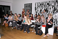 85 Broads members attend the Yuna Yang fashion show, at the close of the 85 Broads Presents Yuna Yang trunk show at Art Gate Gallery on October 24th 2011.