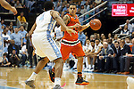 20 February 2016: Miami's Angel Rodriguez (13) and North Carolina's Isaiah Hicks (4). The University of North Carolina Tar Heels hosted the University of Miami Hurricanes at the Dean E. Smith Center in Chapel Hill, North Carolina in a 2015-16 NCAA Division I Men's Basketball game. UNC won the game 96-71.