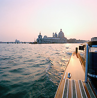 Basilica di Santa Maria della Salute, St Mary of Health, seen from a motor boat in Venice, Italy