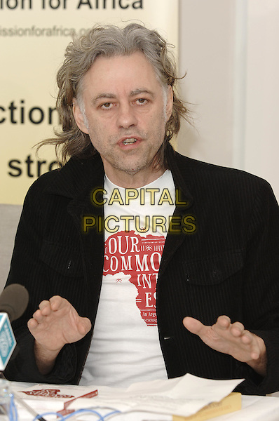 """Sir BOB GELDOF.At Press Launch for  Penguin published book """"Our Common Interest, The Comission for Africa: An Arguement"""".(Bob is co-founder of LiveAid) .Penguin, 80 Strand, .London 9 June 2005.half length hands gesture.Ref: PL.www.capitalpictures.com.sales@capitalpictures.com.© Phil Loftus/Capital Pictures."""