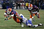 Clemson's running back Jamie Harper gets tackled by UK cornerback Paul Warford in the second half of the UK football game against Clemson at L. P. Field for the Gaylord Hotels Music City Bowl on Sunday, Dec. 27, 2009. The Cats lost to the Tigers 21-13. Photo by Adam Wolffbrandt | Staff