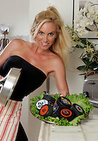 22 June 2005:  Brandy Blake, wife of NHL player Rob Blake bakes up some pucks in the kitchen in Beverly Hills during The Not so Desperate, Desperate housewives shoot on location in Los Angeles with NHL hockey players wives for Editorial Use Only!  Mandatory Credit:  Shelly Castellano.com or Price Doubles. .