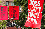 Syed Hussan from No One is Illegal speaks at the rally before the march for Jobs, Justice and the Climate. On July 5th more than 10,000 people gathered in Toronto, the traditional territories of the Missisauga peoples, for the March for Jobs, Justice and the Climate. The march told the story of a new economy that works for people and the planet. People marched for an economy that starts with justice, creates good work, clean jobs and healthy communities. The people recognize that we have solutions and we know who is responsible for causing the climate crisis. (Photo: Robert van Waarden