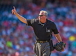 8 June 2013: MLB Umpire Tim Welke signals one more warm-up pitch during a game between the Minnesota Twins and the Washington Nationals at Nationals Park in Washington, DC. The Twins edged out the Nationals 4-3 in 11 innings. Mandatory Credit: Ed Wolfstein Photo *** RAW (NEF) Image File Available ***