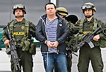 "Colombia's policemen escort to Costa Rican Alejandro Jimenez, also known as ""Palidejo"" suspected of ordering the murder of Argentine folk singer Facundo Cabral during his extradition process in Bogota, Colombia. 13/03/2012.  Photo by Nestor Silva / VIEWpress."