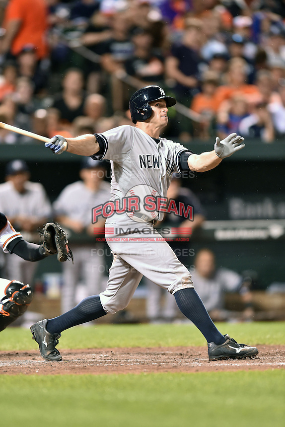 New York Yankees left fielder Brett Gardner #11 swings at a pitch during a game against the Baltimore Orioles at Oriole Park at Camden Yards August 11, 2014 in Baltimore, Maryland. The Orioles defeated the Yankees 11-3. (Tony Farlow/Four Seam Images)