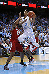 24 February 2015: North Carolina's J.P. Tokoto (13) and NC State's Ralston Turner (22). The University of North Carolina Tar Heels played the North Carolina State University Wolfpack in an NCAA Division I Men's basketball game at the Dean E. Smith Center in Chapel Hill, North Carolina. NC State won the game 58-46.