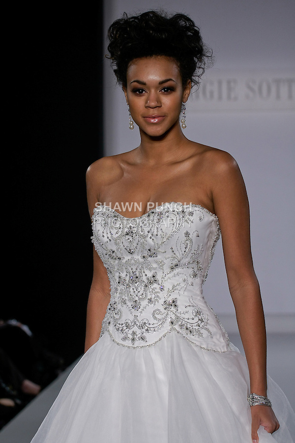 Model walks runway in an Alison wedding gown from the Maggie Sottero Spring 2013 collection, at The Couture Show, during New York Bridal Fashion Week, on October 14, 2012.