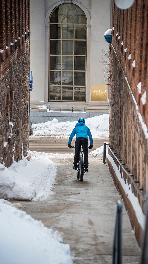 Winter urban fat bike riding in downtown Marquette, Michigan.