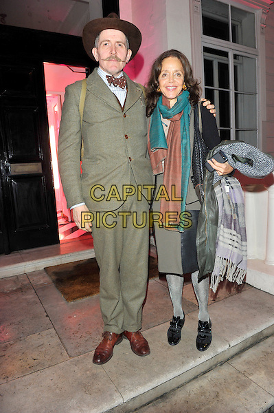 Billy Childish & guest.W Magazine and Jimmy Choo dinner in honour of artist Rob Pruit, Held at 35 Belgrave Square, London, England..October 11th, 2012.full length brown hat beige suit moustache mustache facial hair scarf pink teal.CAP/CJ.©Chris Joseph/Capital Pictures.